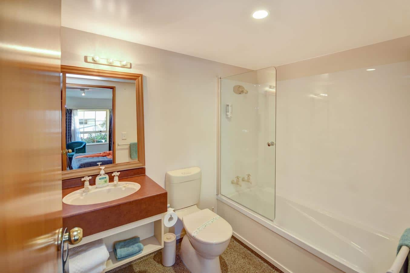 Bathroom with bath, sink and toilet